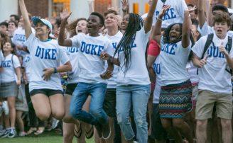 Duke students jumping at class photo shoot.