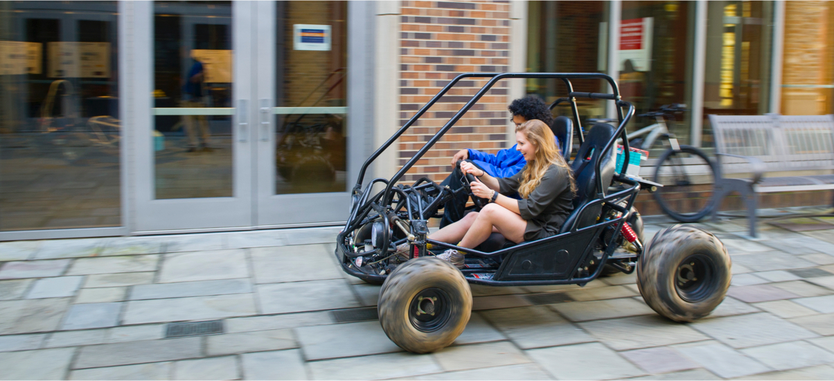 two students racing in a self-built motor car
