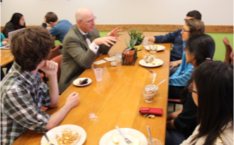students and faculty eating lunch together around a table