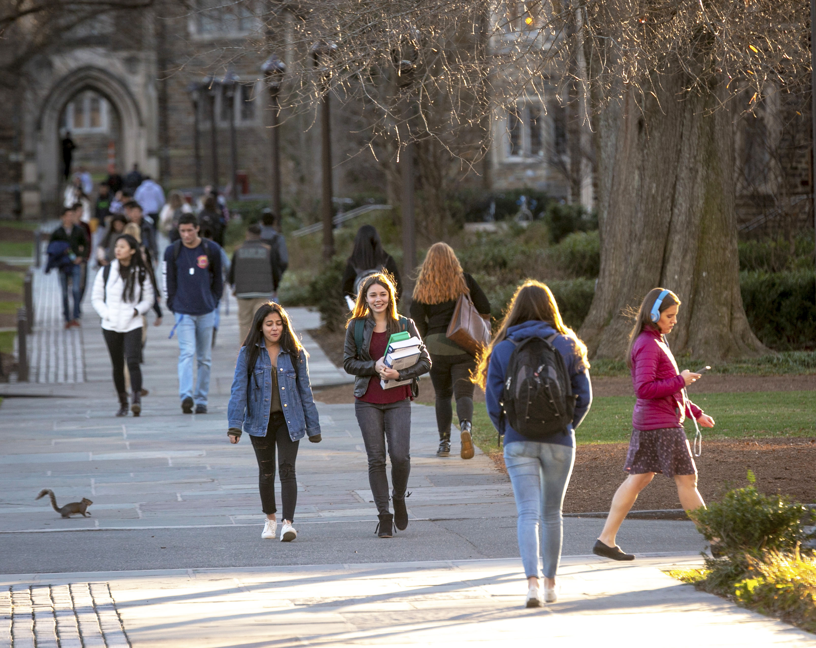 students walking across West Campus in the fall