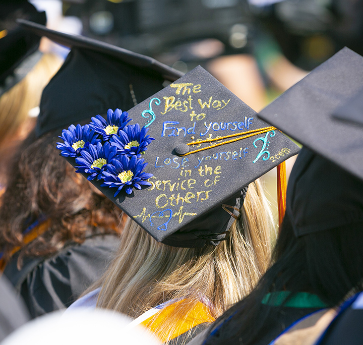 back of a student's graduation cap with color writing that says