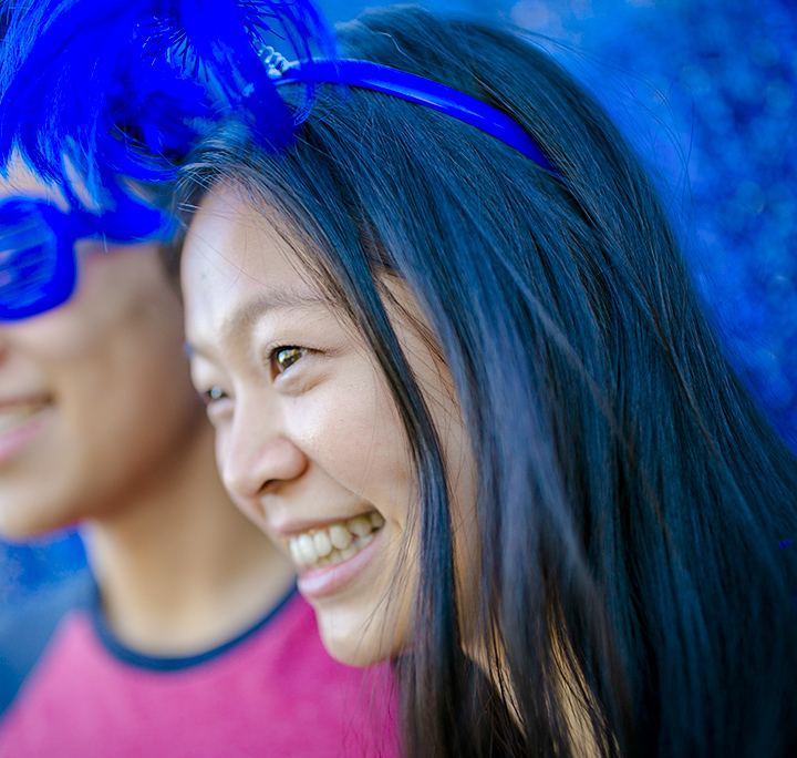 girl smiling and looking away with festive duke blue headband