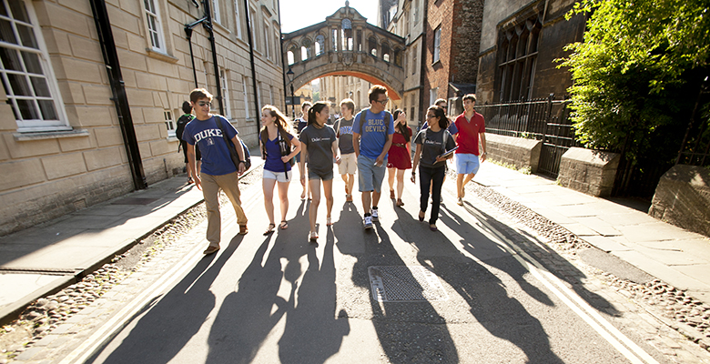 duke students walking and talking through the New College campus in Oxford, England