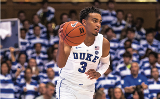 Duke basketball player #3 Tre Jones dribbling basketball during a game