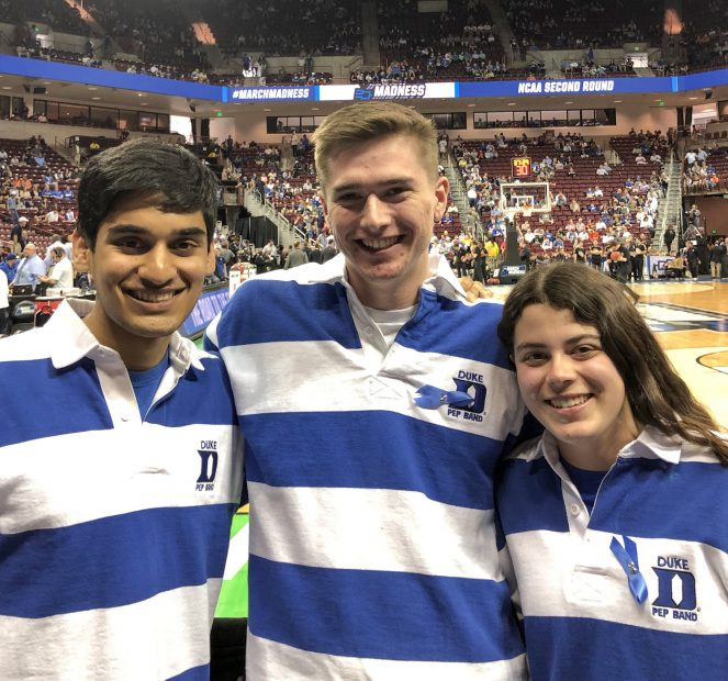 Image of Sagar and three other pep bandmates wearing blue and white shirts